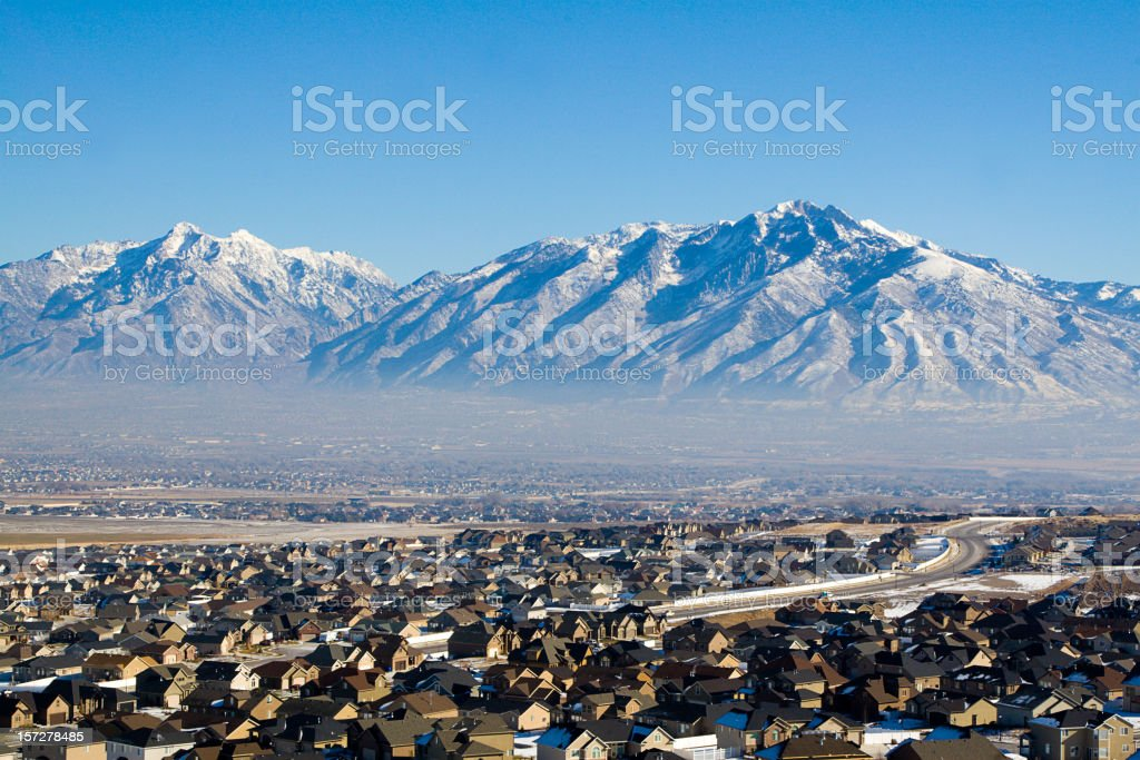 Neighborhood Under Snow-Capped Mountains stock photo