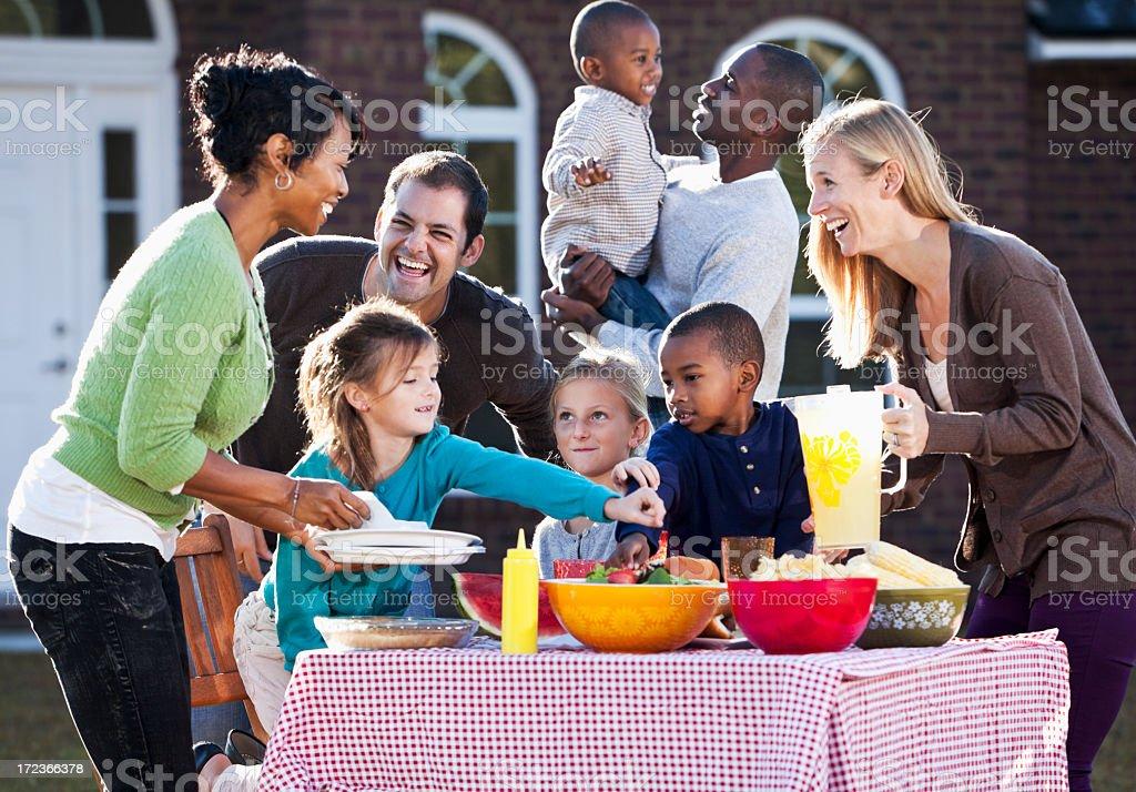 Neighbors having picnic stock photo