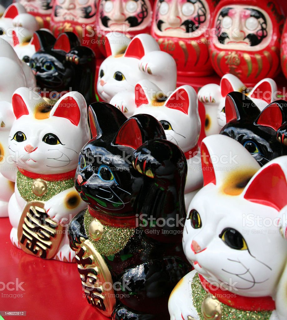 Neko cats asking for coins to deposit inside of them stock photo