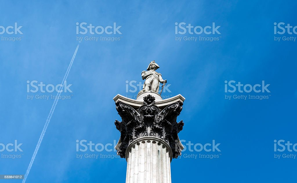 Nelson's column and vapour trail stock photo