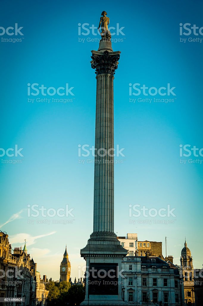 Nelson's Column in golden light with Big Ben in the background stock photo