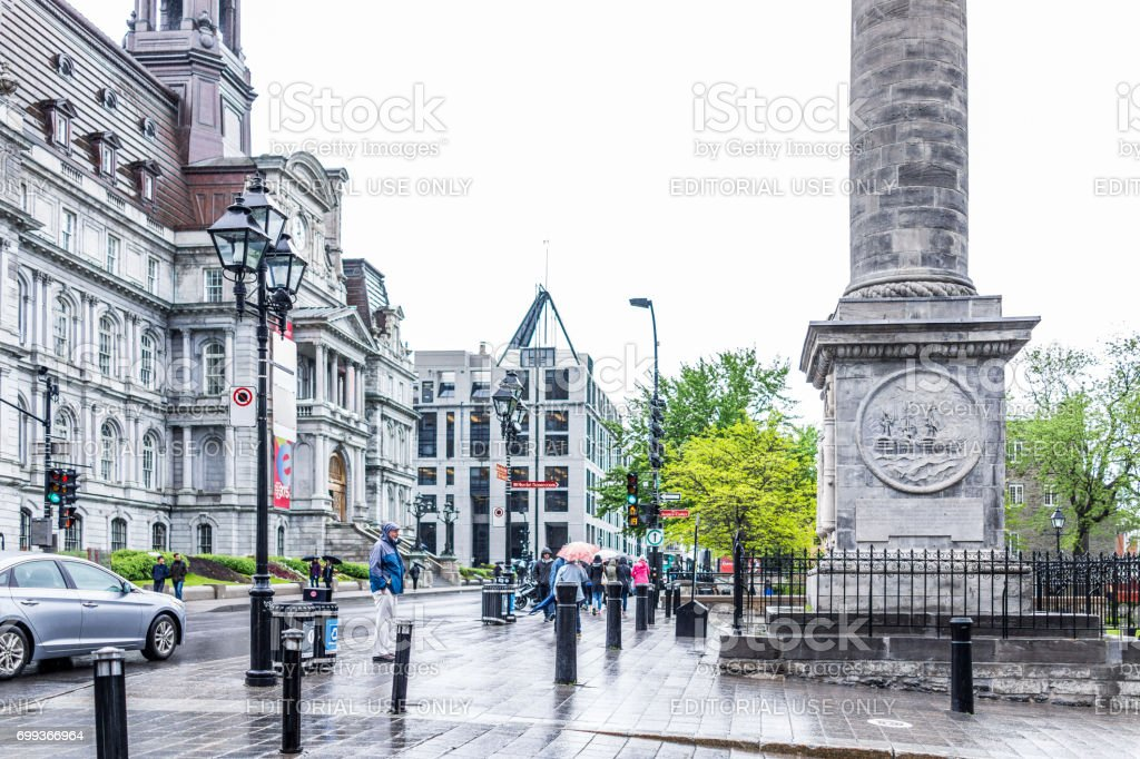 Nelson's column in Quebec region with people walking in rainy cloudy wet day stock photo