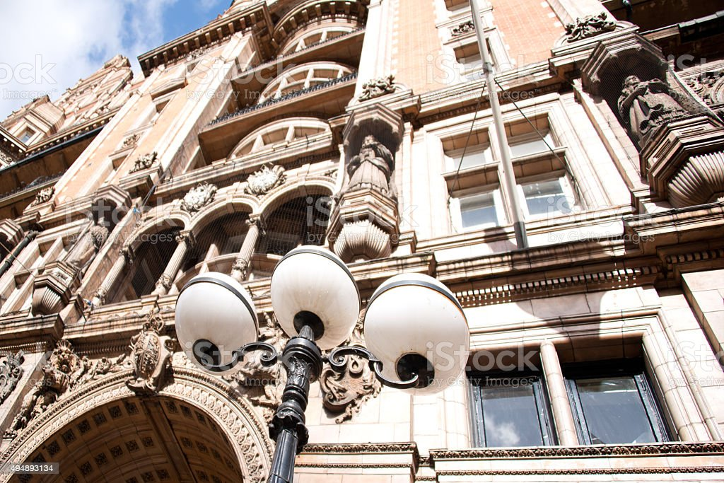 Neoclassical Old English Stonework Facade with Sculpture Pediments stock photo