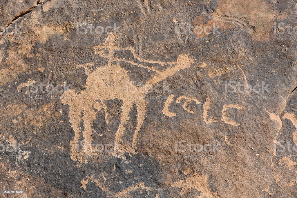 Neolitic rock carving of man on camel, ubba (Saudi Arabia) stock photo