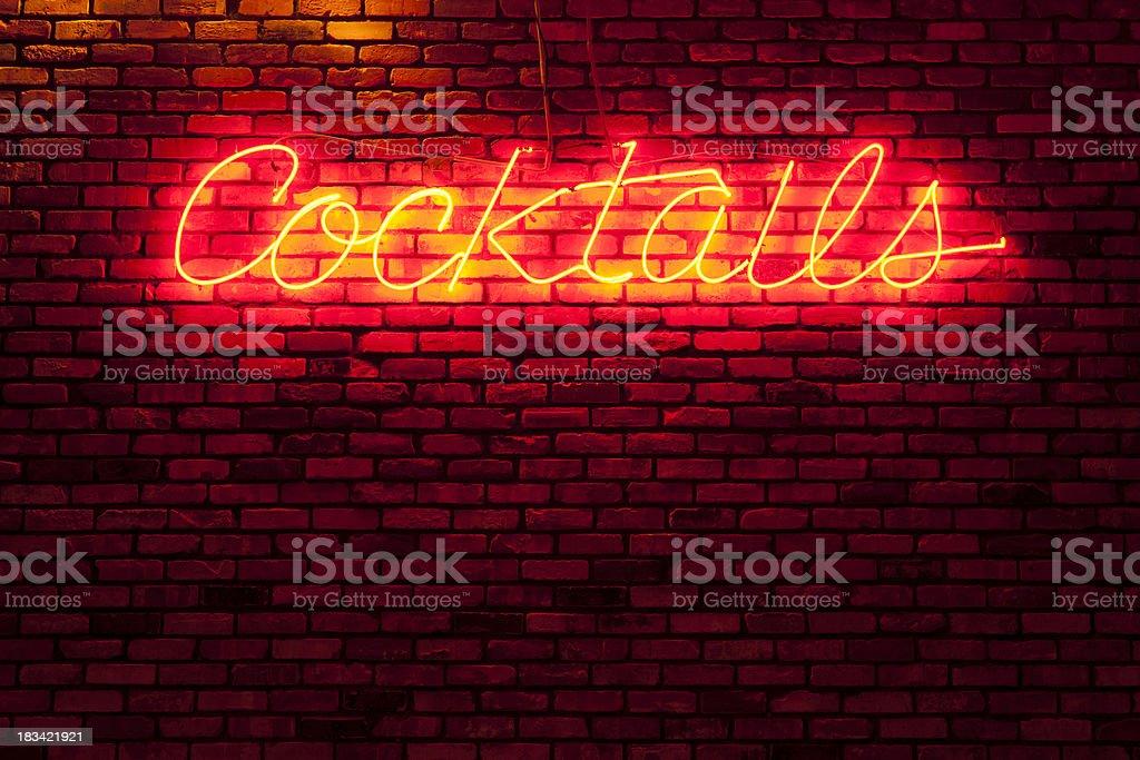 Neon bar sign on a brick wall stock photo