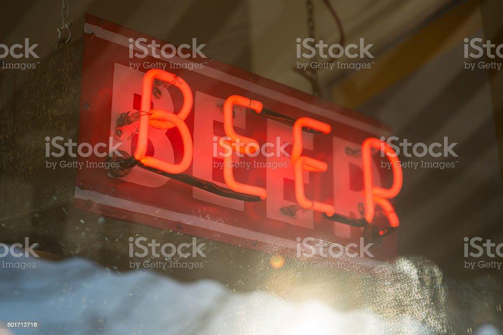 Neon Beer Sign in window stock photo