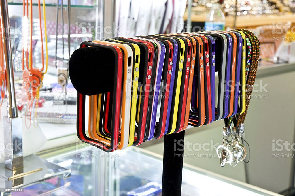 Neon Colored Cellphone Cases In Retail Display royalty-free stock photo