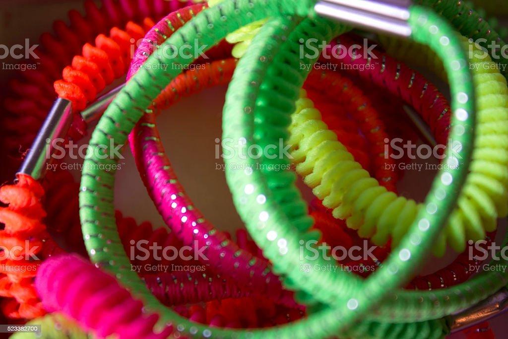 Neon colored hair elastics stock photo