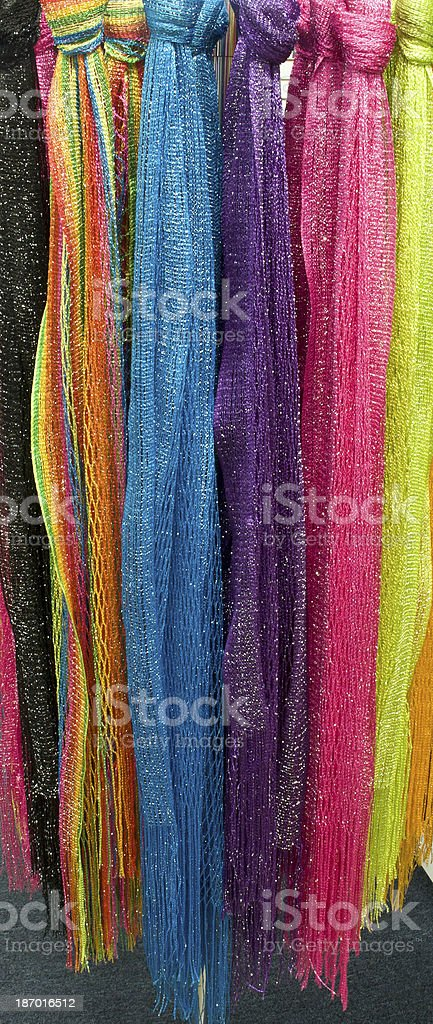 Neon Colorful Scarves Hanging In Retail Store Display royalty-free stock photo