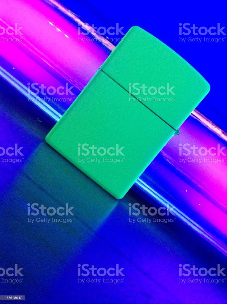 Neon fluorescent Wind proof Lighter with Ultra Violet Light stock photo