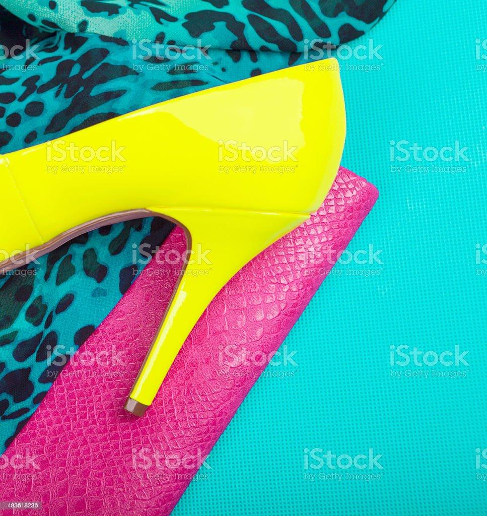 Neon high heel, dress and snakeskin print bag stock photo
