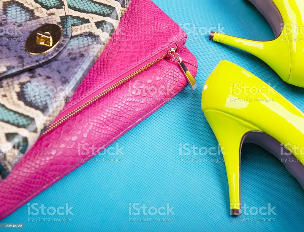 Neon high heels, dress and snakeskin print bag stock photo