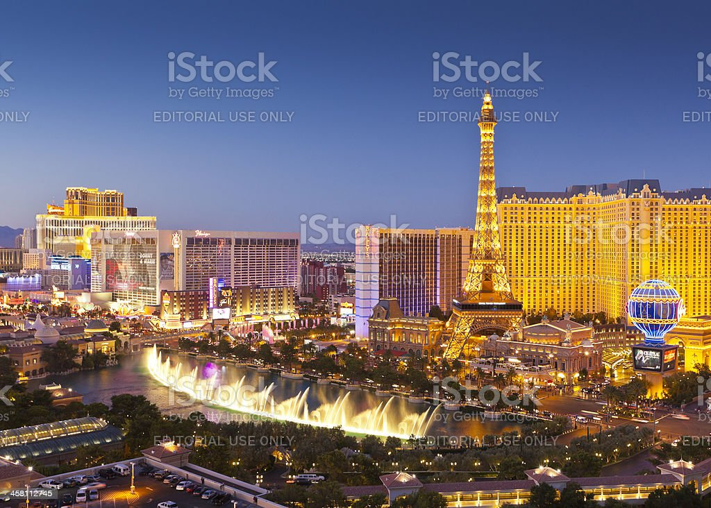 Neon illuminations of Las Vegas Strip at sunset stock photo