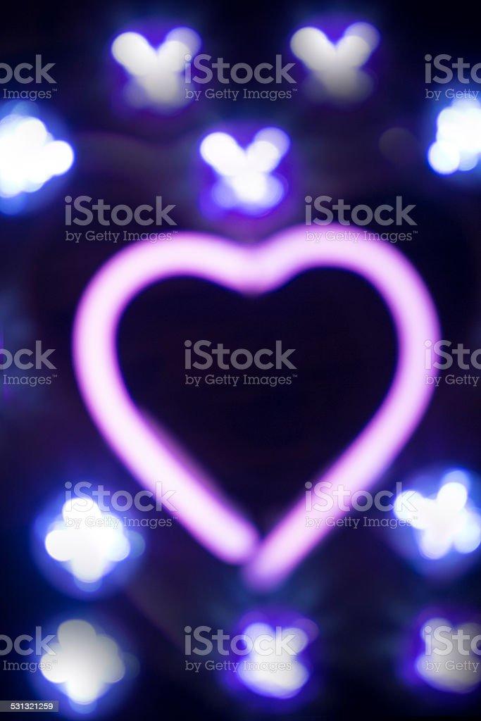 Neon love heart shape sign at night royalty-free stock photo