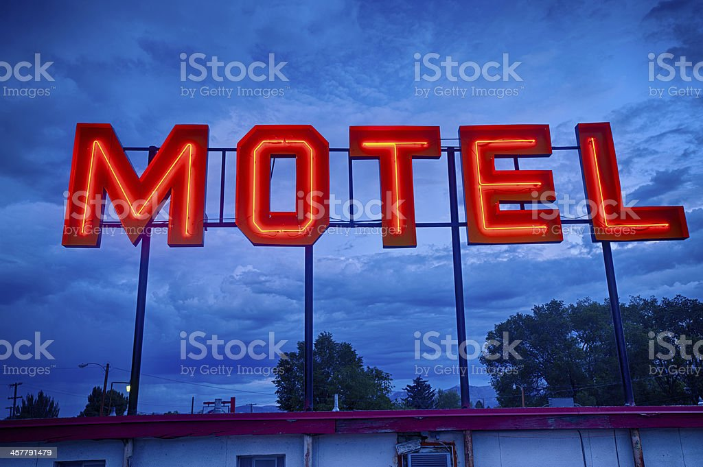 Neon Motel Sign at night in a storm stock photo