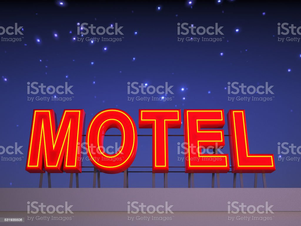 Neon motel sign with a night sky. stock photo