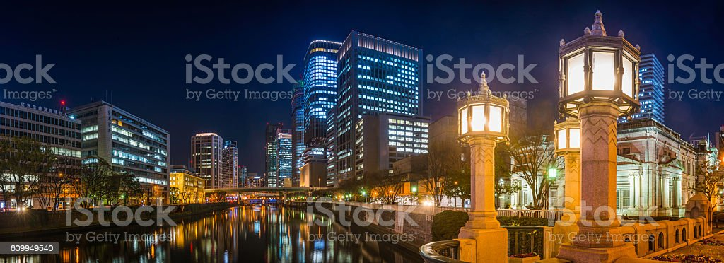 Neon night futuristic cityscape panorama illuminated lamplight Osaka Japan stock photo