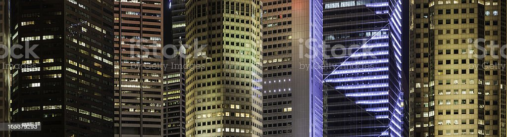 Neon night skyscrapers colorful business background stock photo