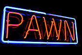 Neon PAWN shop sign lights up the night