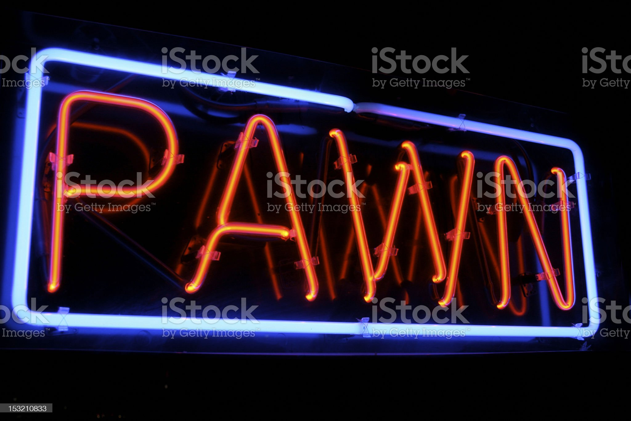 Neon PAWN shop sign lights up the night royalty-free stock photo
