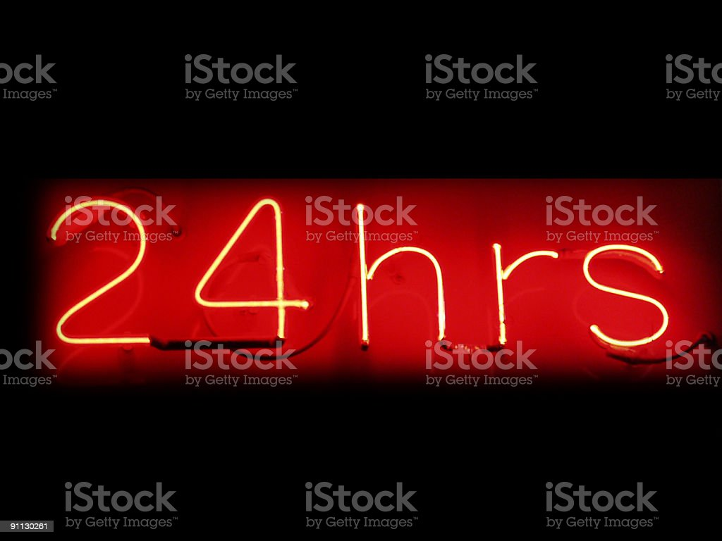Neon red sign 24 hrs stock photo