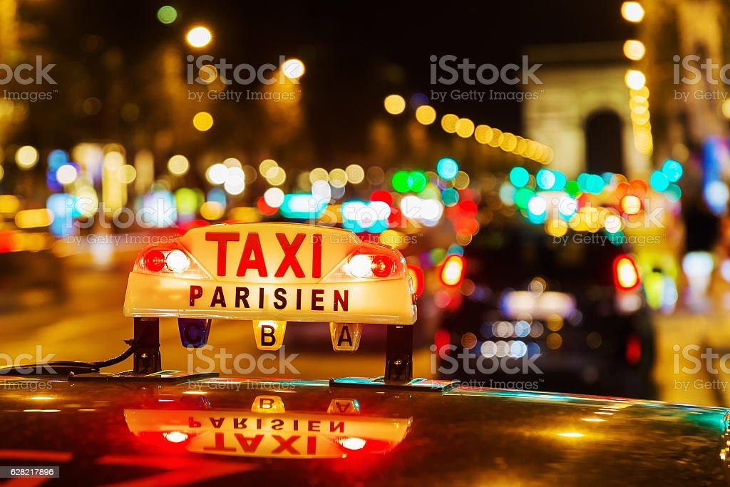 neon sign of a Parisian taxi at night stock photo
