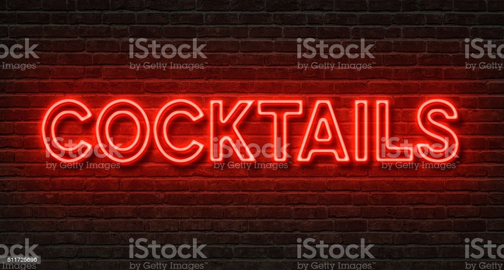 Neon sign on a brick wall - Cocktails stock photo