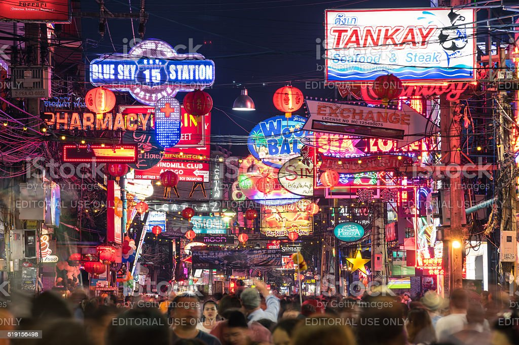 Neon signs and blurred people on Walking Street of Pattaya stock photo