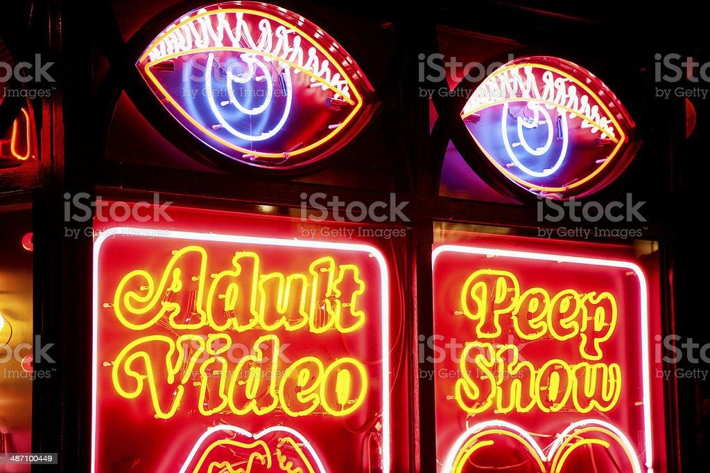 Neon strip club sign stock photo