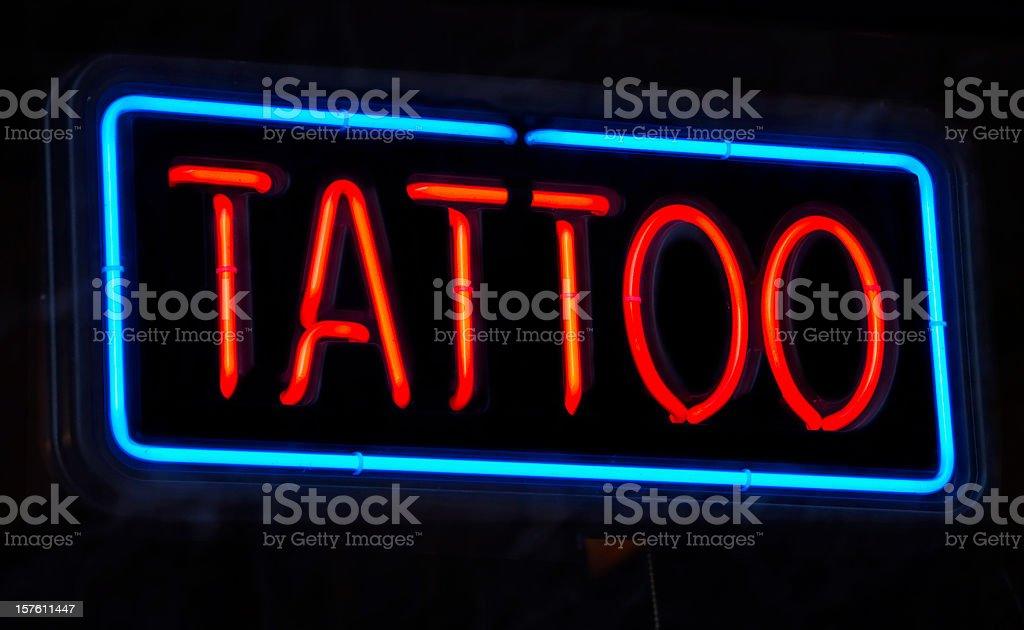 Neon Tattoo Sign royalty-free stock photo
