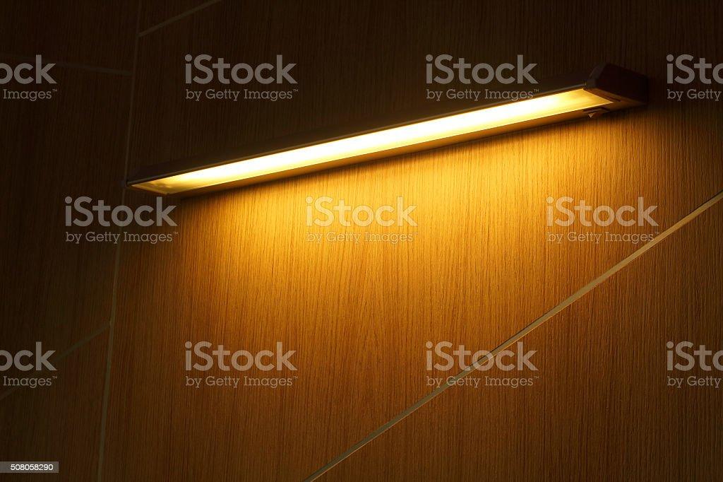 Neon tube yellow light stock photo