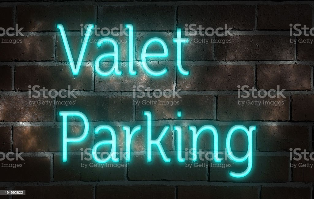 Neon 'valet parking' sign stock photo