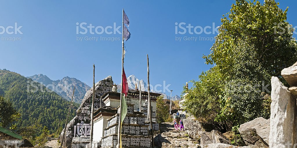 Nepal buddhist mani stones porters stupa shrine Everest trail Himalayas stock photo