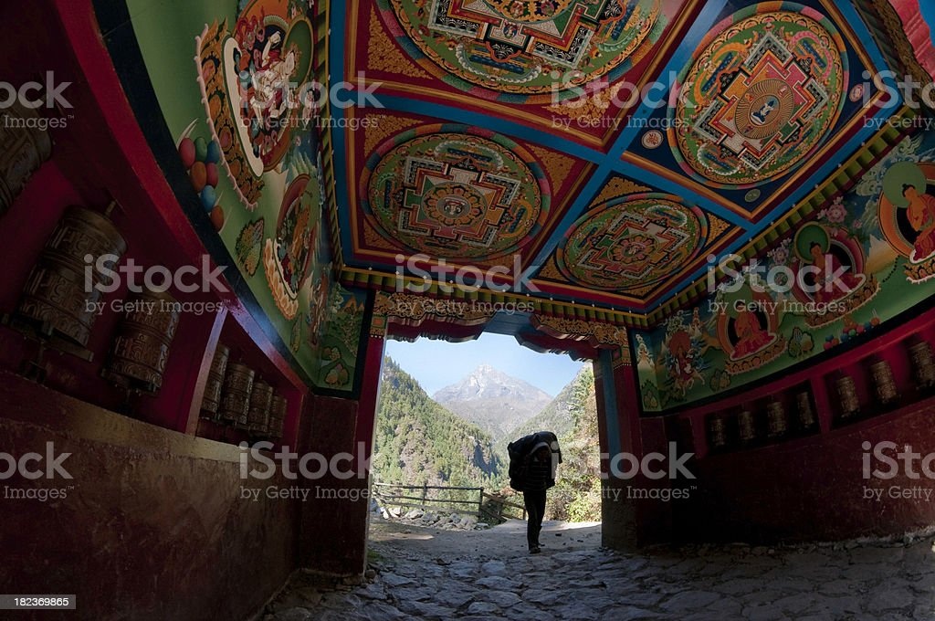 Nepal Everest trail ceremonial gate to mountains porter carrying load royalty-free stock photo