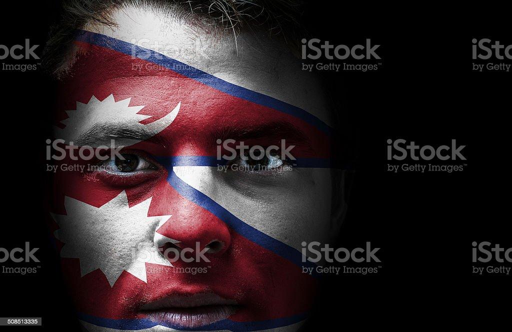 Nepal flag on face stock photo