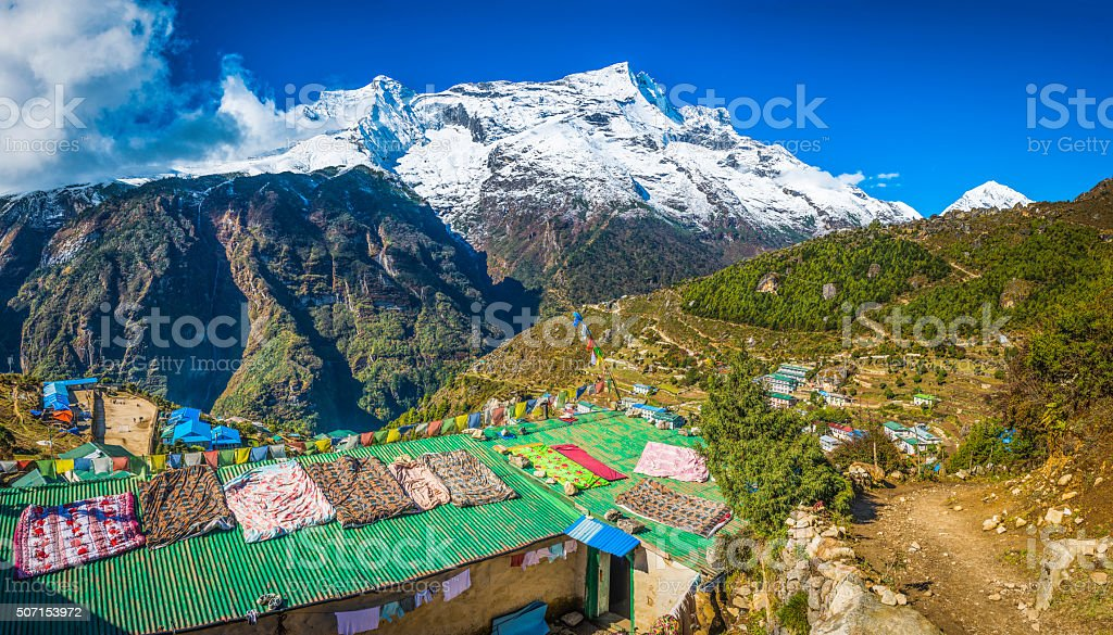 Nepal prayer flags teahouses Namche Bazaar Sherpa village Himalaya mountains stock photo