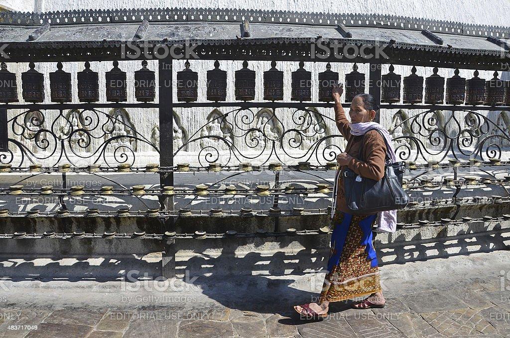 Nepal  Scene: Kathmandu, the woman makes the crust at Swayambhunath Hill royalty-free stock photo