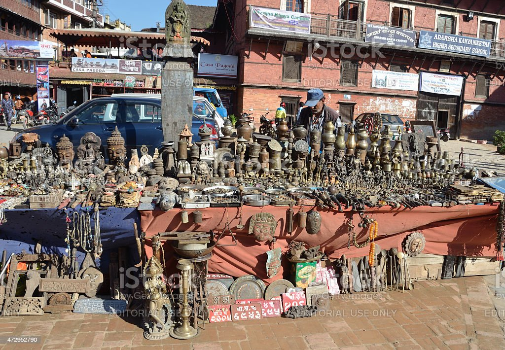Nepal scene: man selling souvenirs in historic center of Patan stock photo