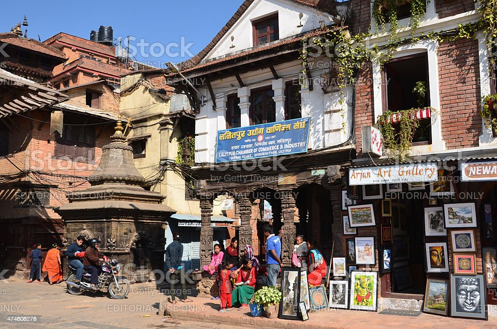Nepal scene: People are in historic centre of Patan stock photo