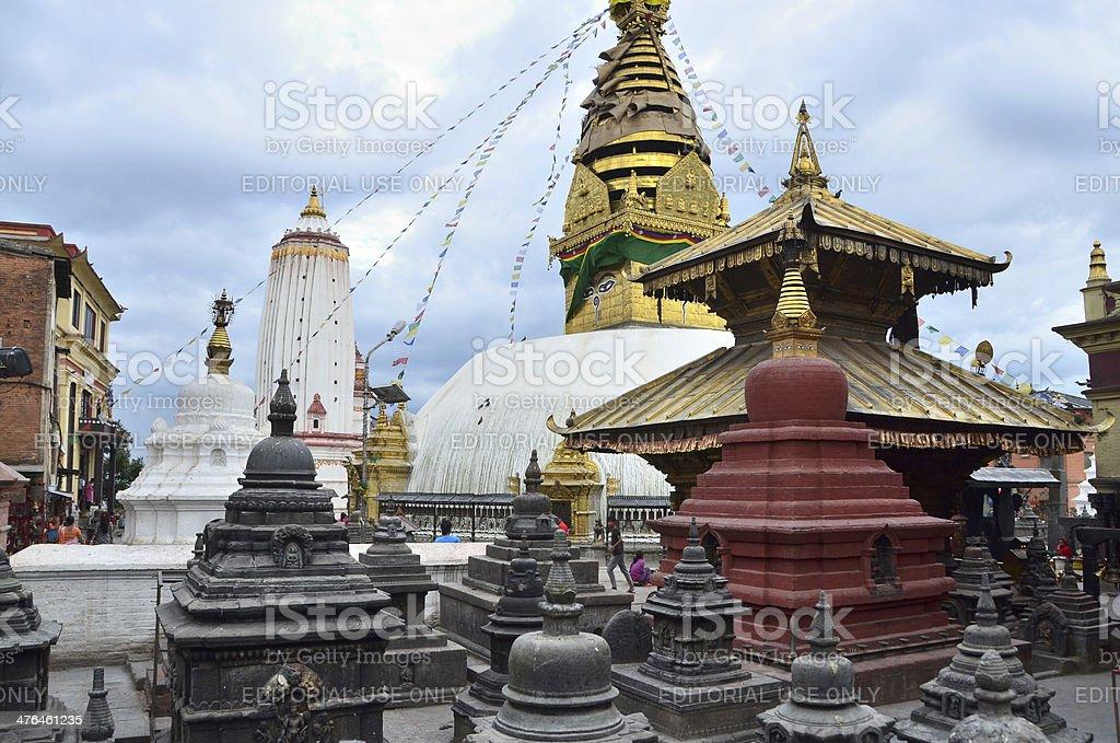 Nepal Scene: Tourists walking in Swayambhunath temple complex royalty-free stock photo