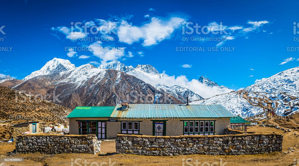 Nepal traditional teahouse lodge Everest National Park Himalaya mountain peaks stock photo