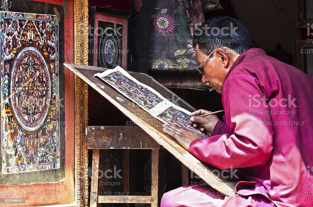 Nepalese artist  creates traditional mandala painting stock photo