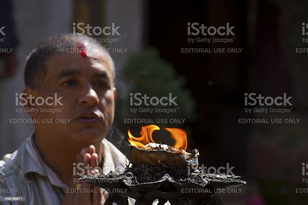 Nepalese brahman man making offering to hindu god royalty-free stock photo