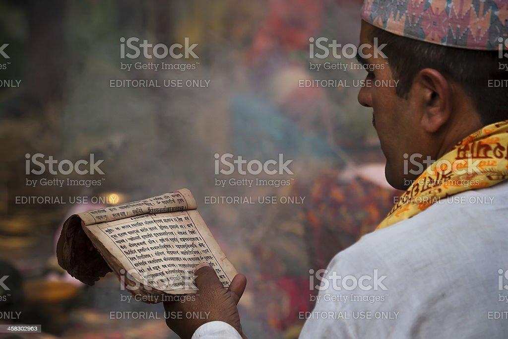 Nepalese Brahman reading Hindu religious mantras stock photo