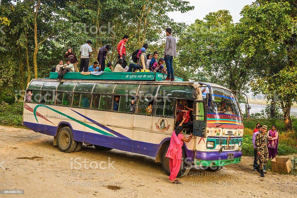 Nepalese bus driving through Chitwan Park stock photo