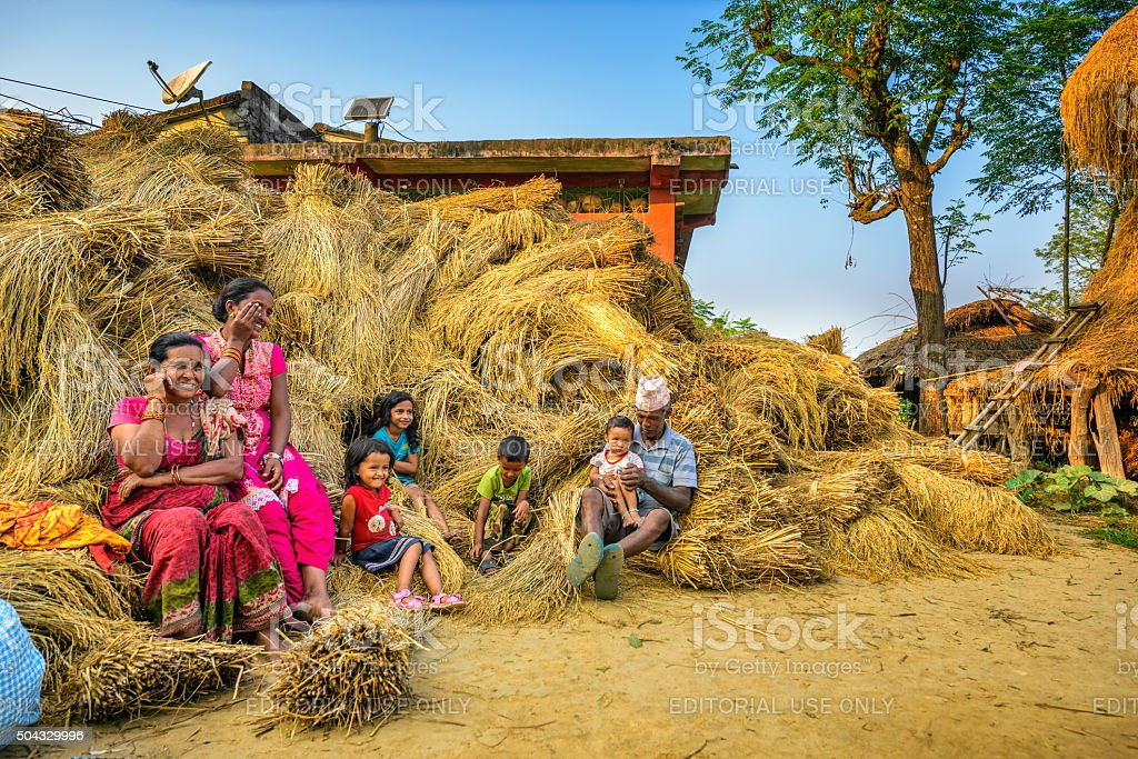Nepalese family relaxing after the harvest stock photo