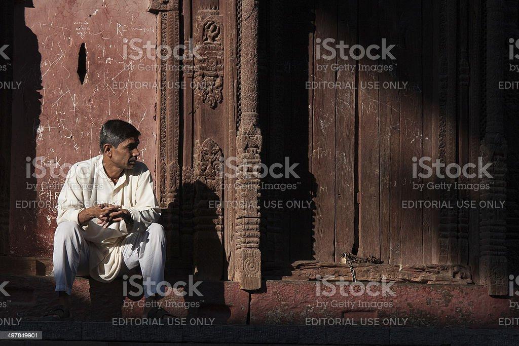 Nepalese man at an ancient temple Durbar Square, Kathmandu, Nepal stock photo