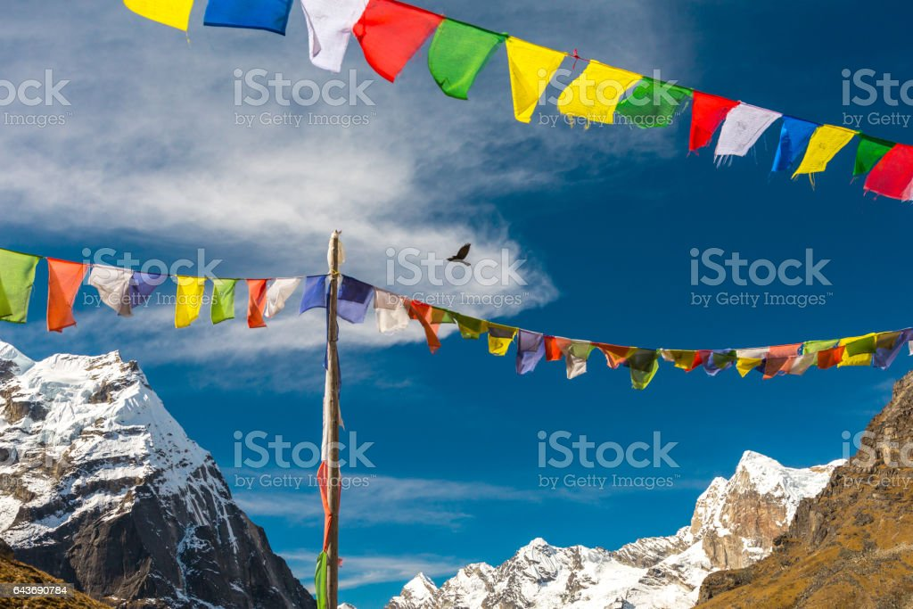 Nepalese Prayer Flags hanging in Wind in Himalaya Mountains stock photo