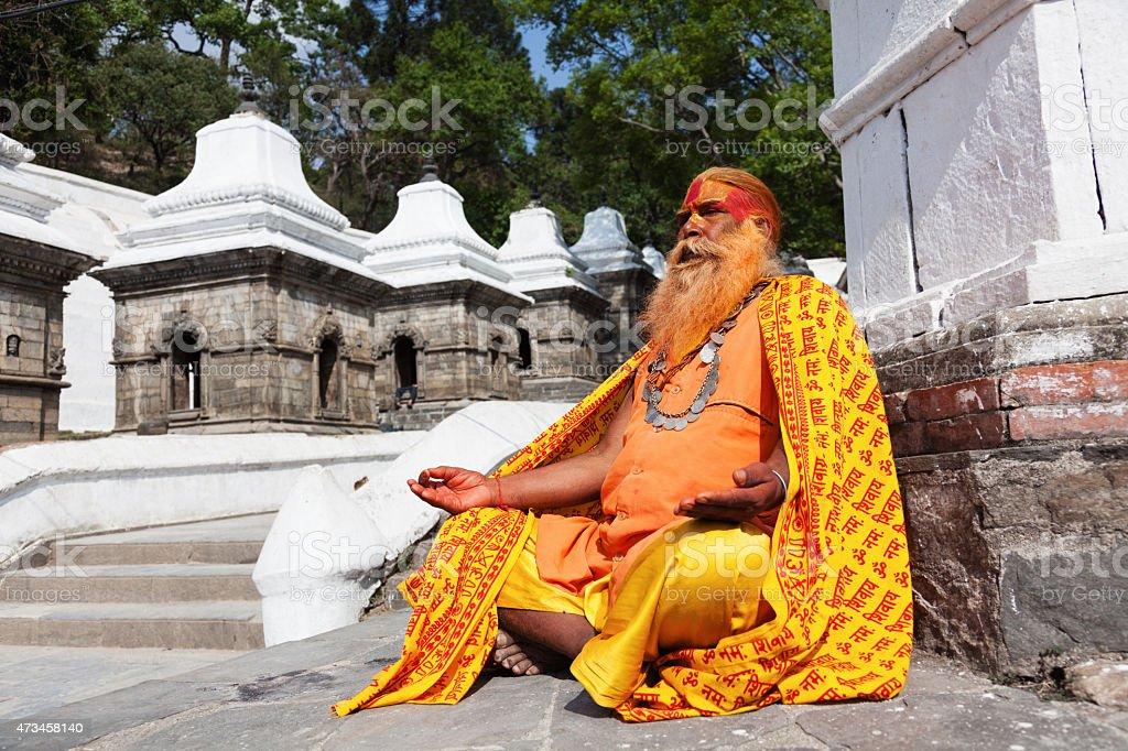 Nepalese sadhu man sitting on the street stock photo