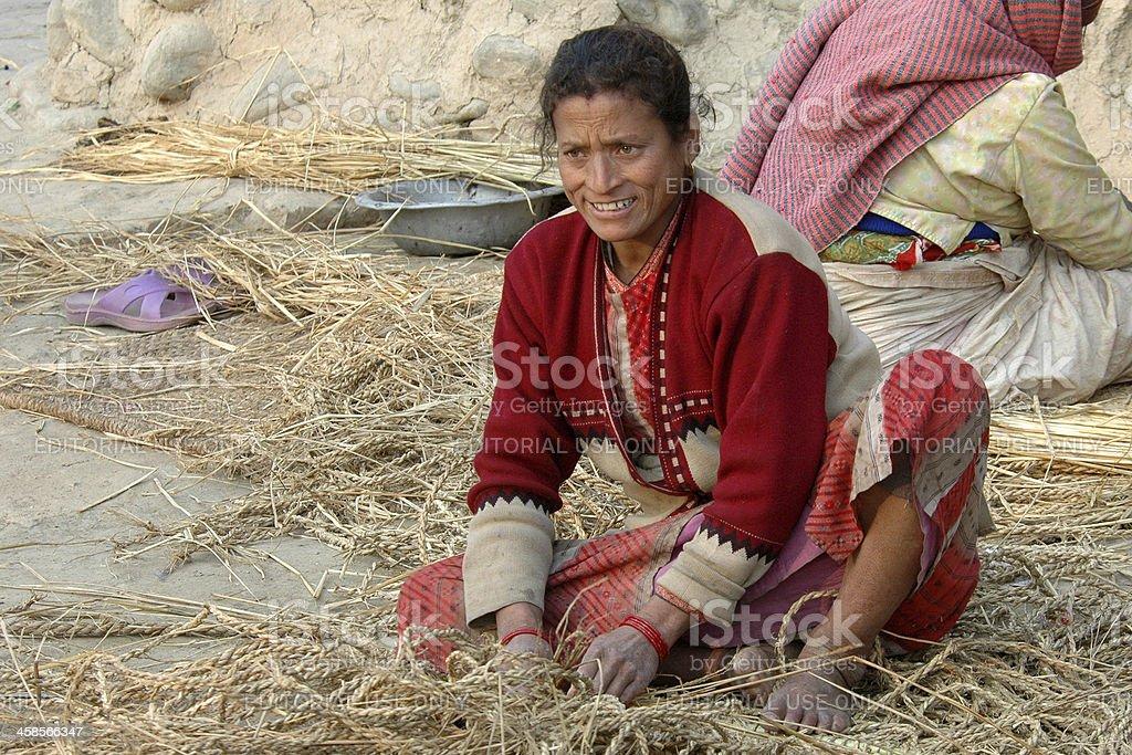 Nepalese woman braiding ropes. stock photo